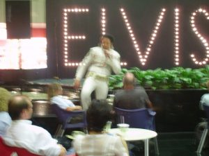 an Elvis impersonator in Singapore airport. Sorry that it's so blurry; it generally doesn't even occur to me to take pictures in airports, so I have very few to choose from. (He was particularly bad, by the way.)