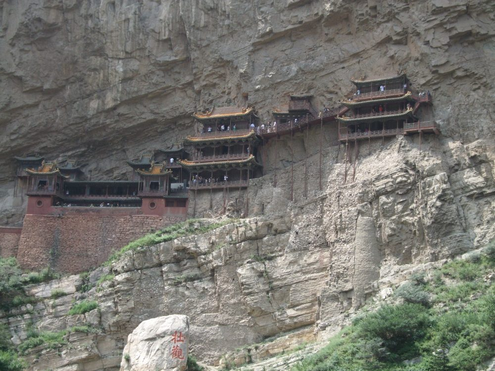 The hanging monastery looks like it's glued to the side of a sheer cliff.