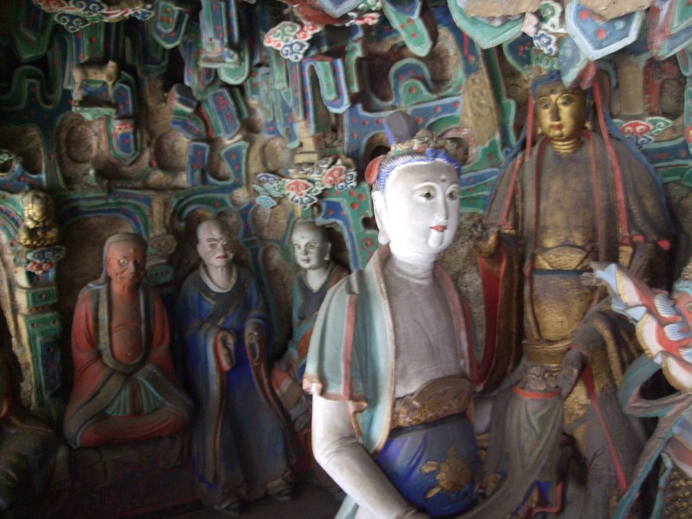 a cluster of carved and painted statues
