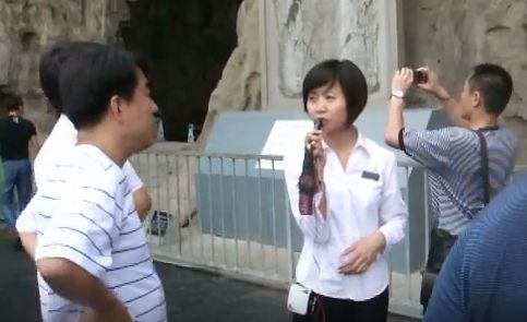 a still from the video shows one of the three tour guides