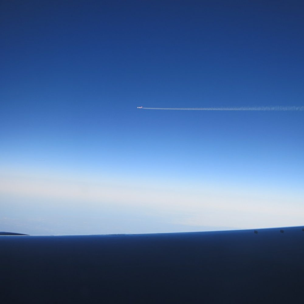 a picture of a plane, taken from a plane; is flying safe?