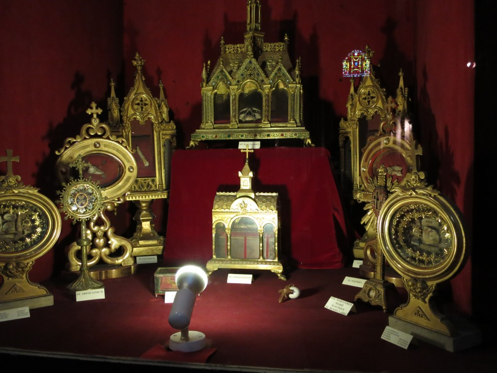 a display case full of relics from 25 different saints