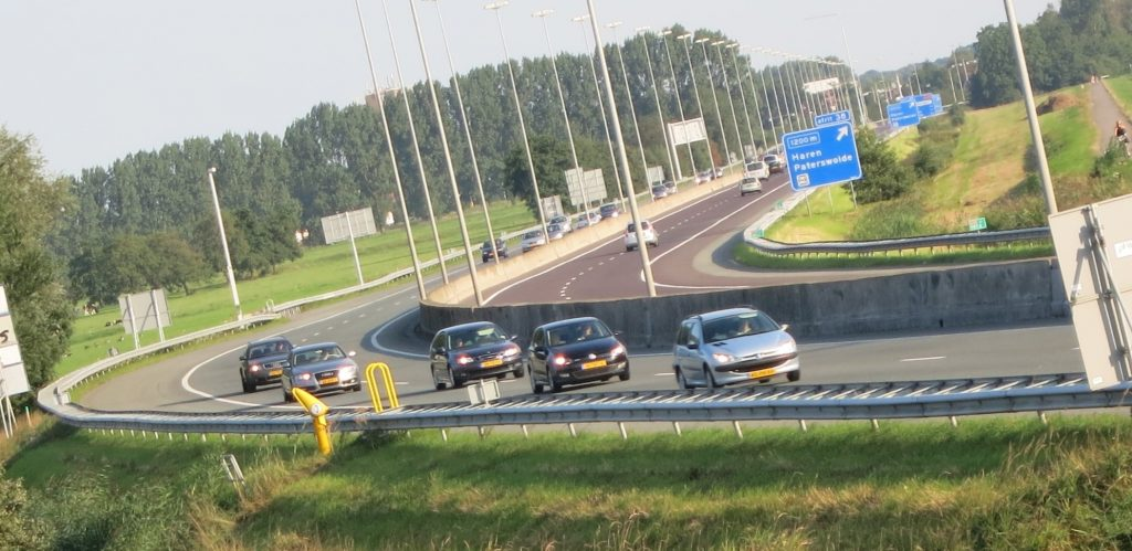 a view over a highway with a few cars passing by
