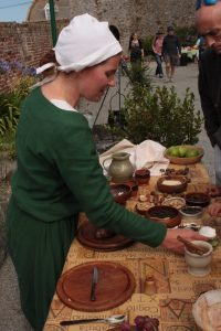 a woman explaining common medieval ingredients