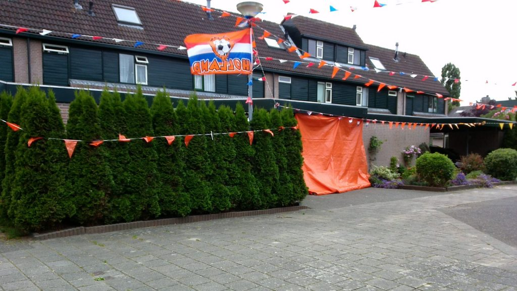 a house in the neighborhood dressed up in preparation for a football-watching party