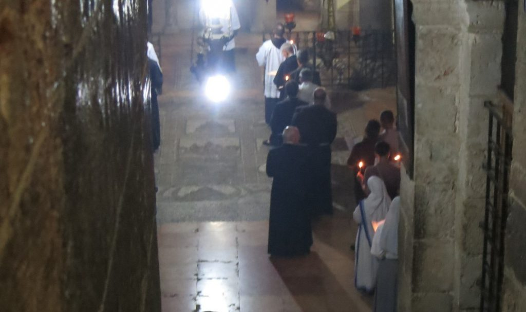 one sect or another holding a ceremony in an underground chapel at the Church of the Holy Sepulchre on the Via Dolorosa