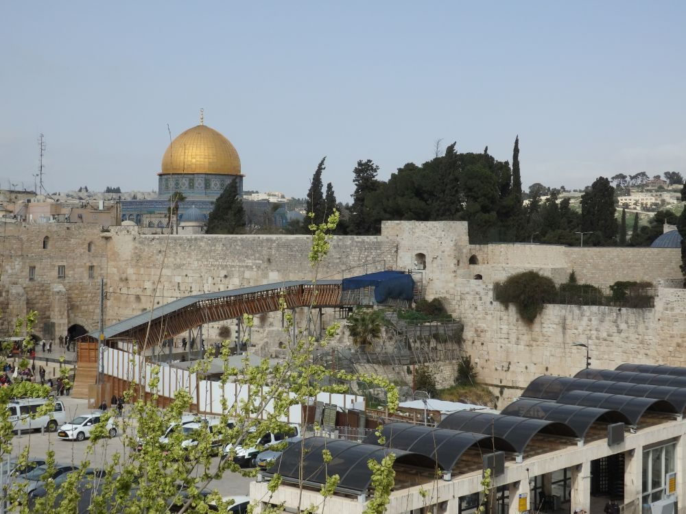 In this view you can see the Dome of the Rock above the Western Wall. The walking bridge up to the Temple Mount is its entrance and is heavily guarded. It always amazes me how literally on top of each other the religions coexist in Jerusalem.