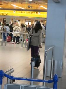 Anne heading to security, portfolio under her arm