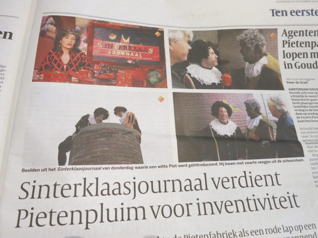 An article in the newspaper about the Sinterklaas news program on TV. This year for the first time a White Pete and a Sooty Pete were included.