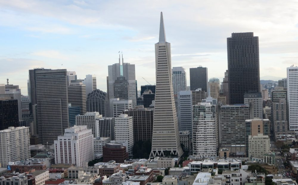 a view of downtown San Francisco seen from Coit Tower, with the Transamerica pyramid in the center. Lots of skyscrapers