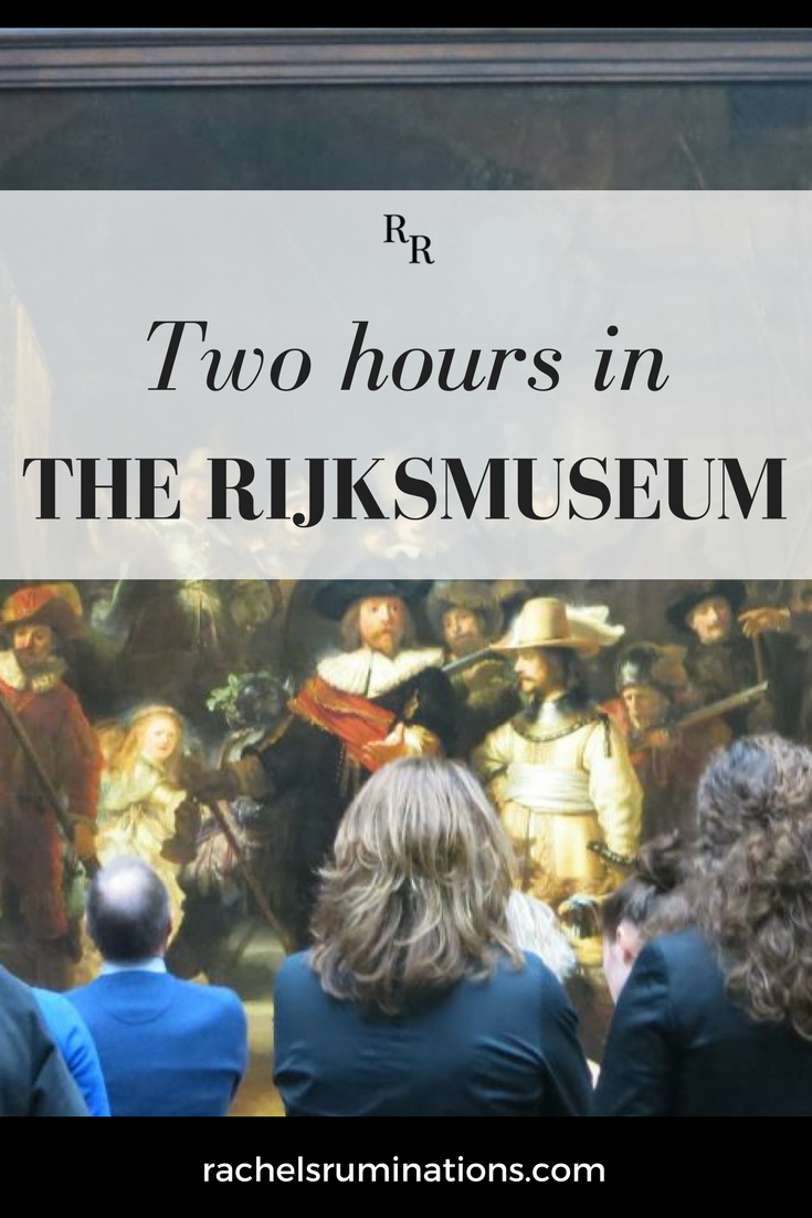 pinnable image text: two hours in the Rijksmuseum image: Rembrandt's The Night Watch, with visitors in front of it, backs to the camera.