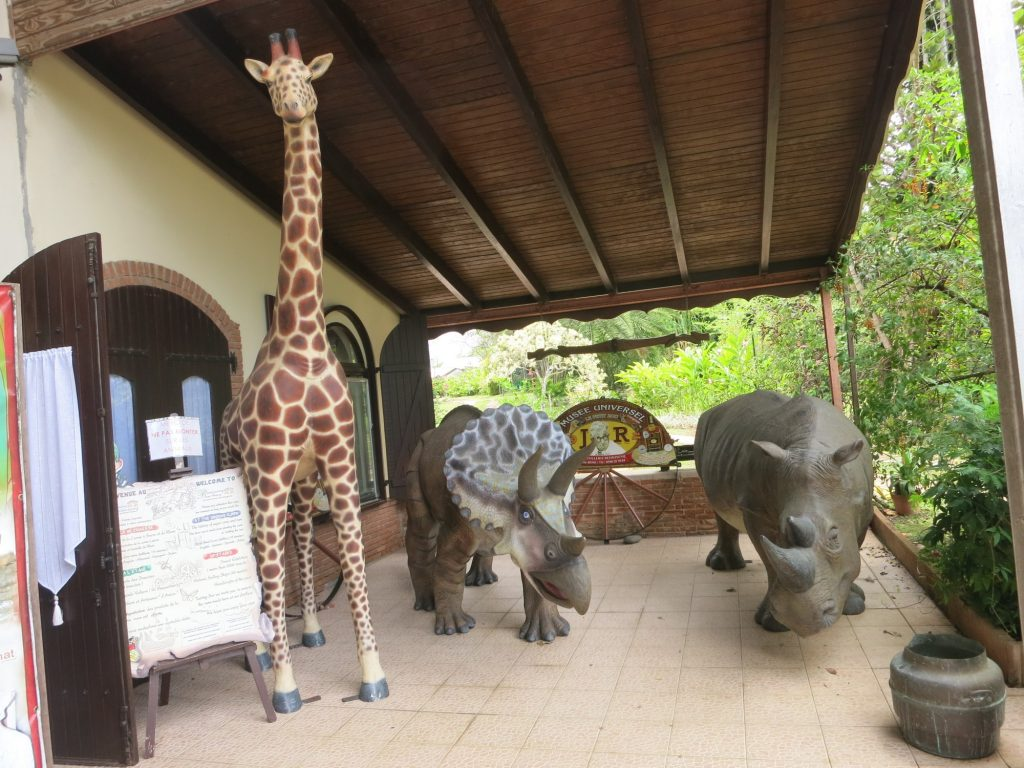 life-sized models of a giraffe, a triceratops and a rhino outside the Rum Museum