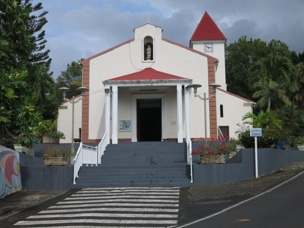 a view of the church in Deshaies, visible in many scenes in Death in Paradise.