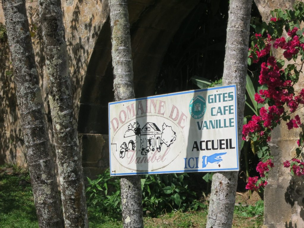 the entrance sign to Vanibel Coffee Plantation:
