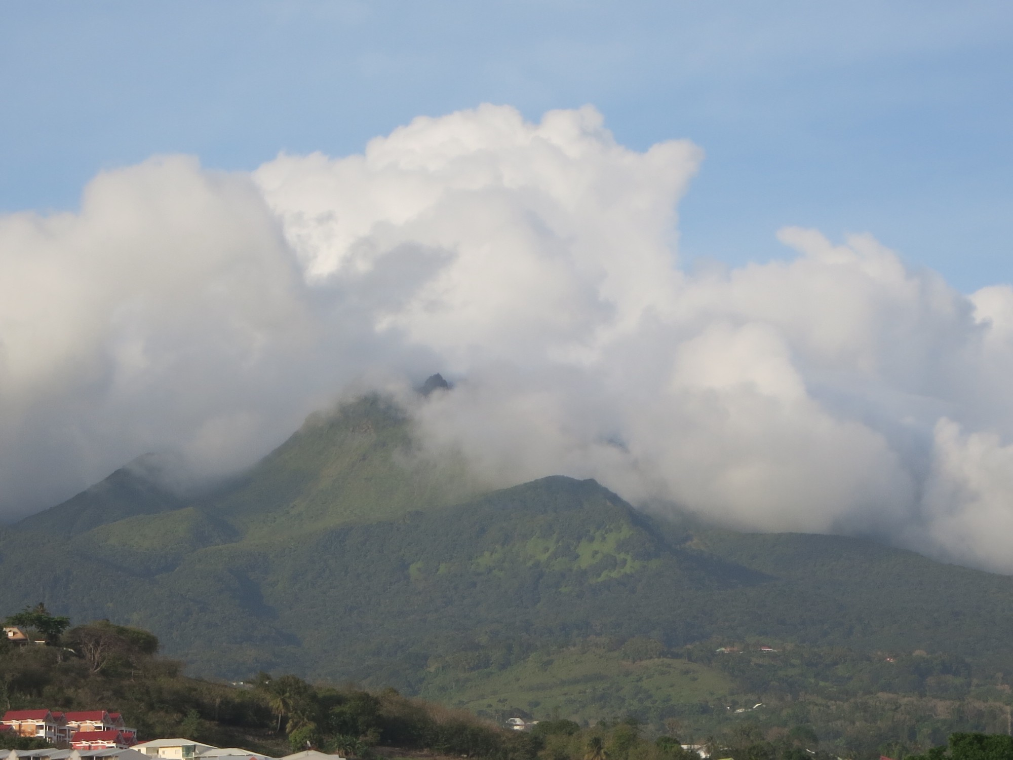 view of La Soufriere volcano, topped with clouds