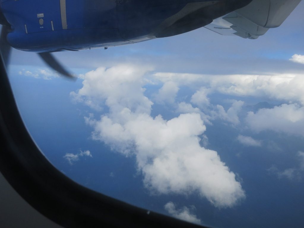 view of clouds looking out the plane's window