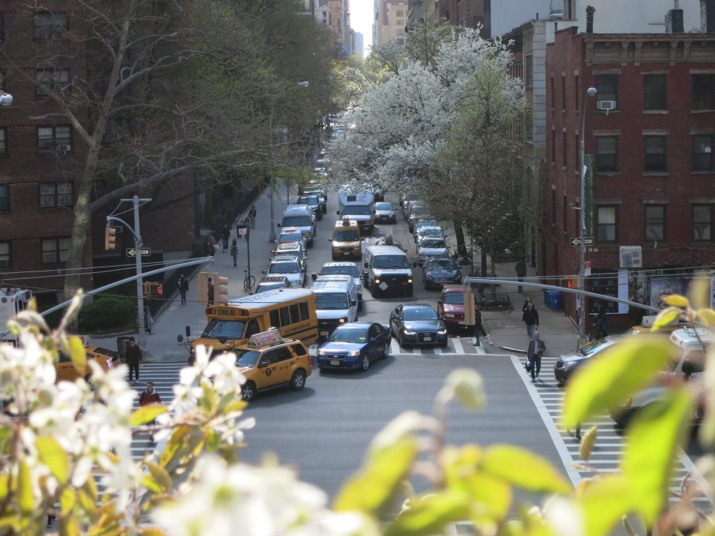 a view from the High Line, looking down on an intersection with traffic