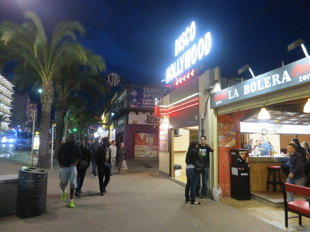 neon-lit fast-food restaurant storefronts in Lloret de Mar