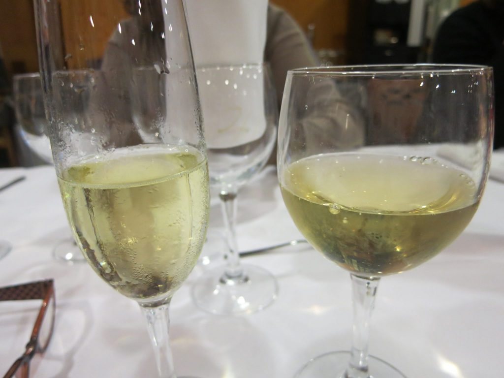 close-up of a glass of cava and a glass of wine