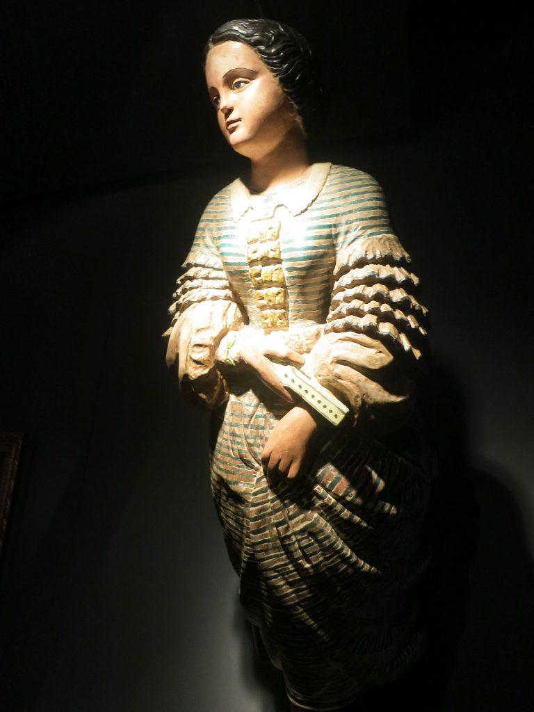 a close-up of a wooden figurehead in the Maritime Museum in Lloret de Mar