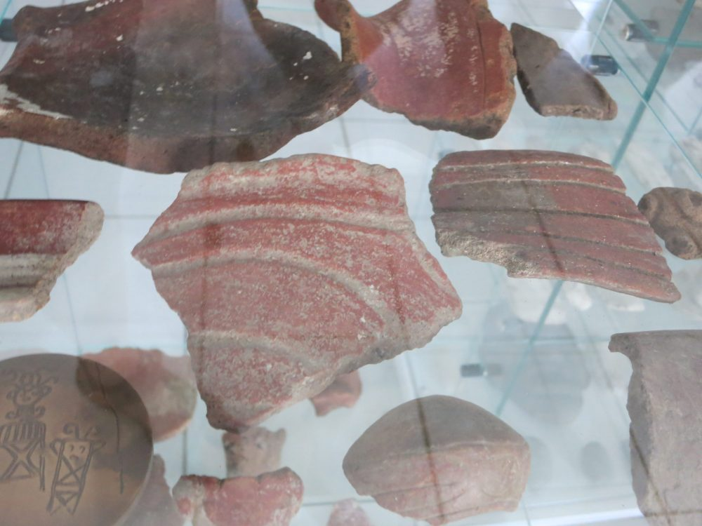 small broken pieces of Native American pottery on display at Kreol West Indies