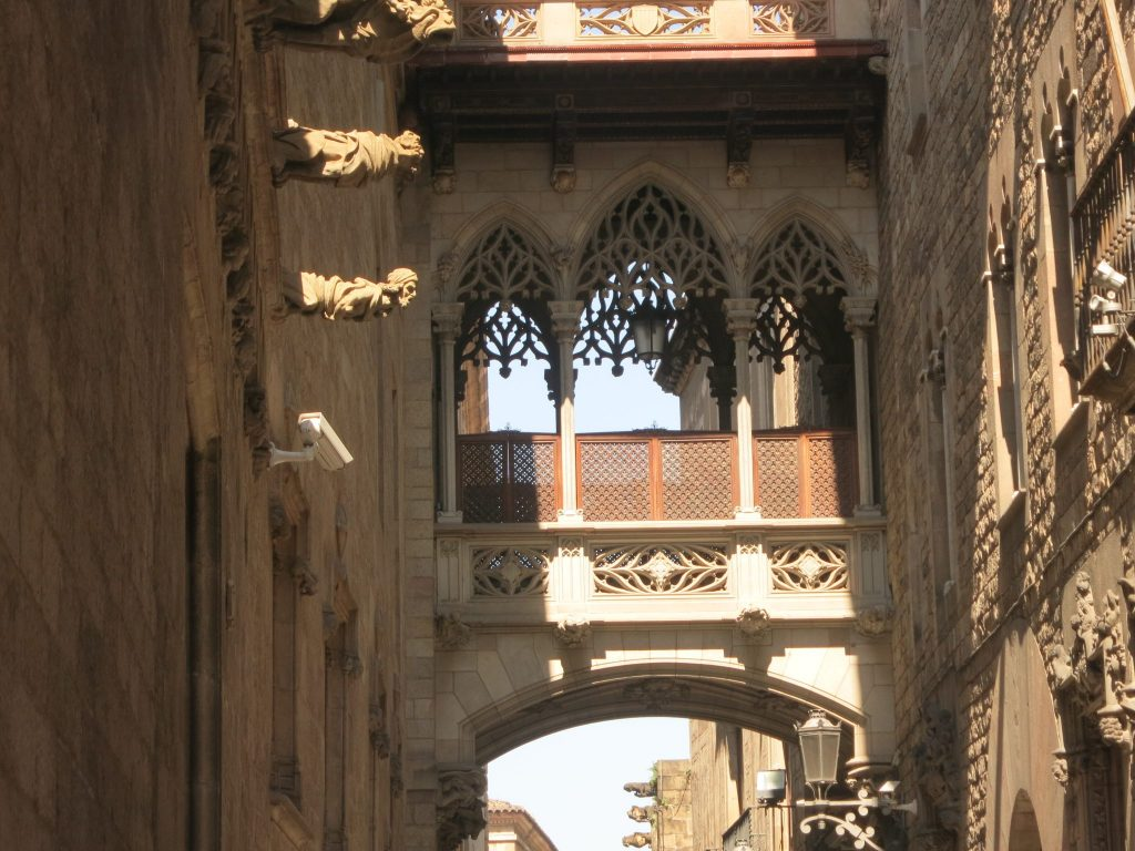 supposedly medieval bridge over the street, with gargoyles