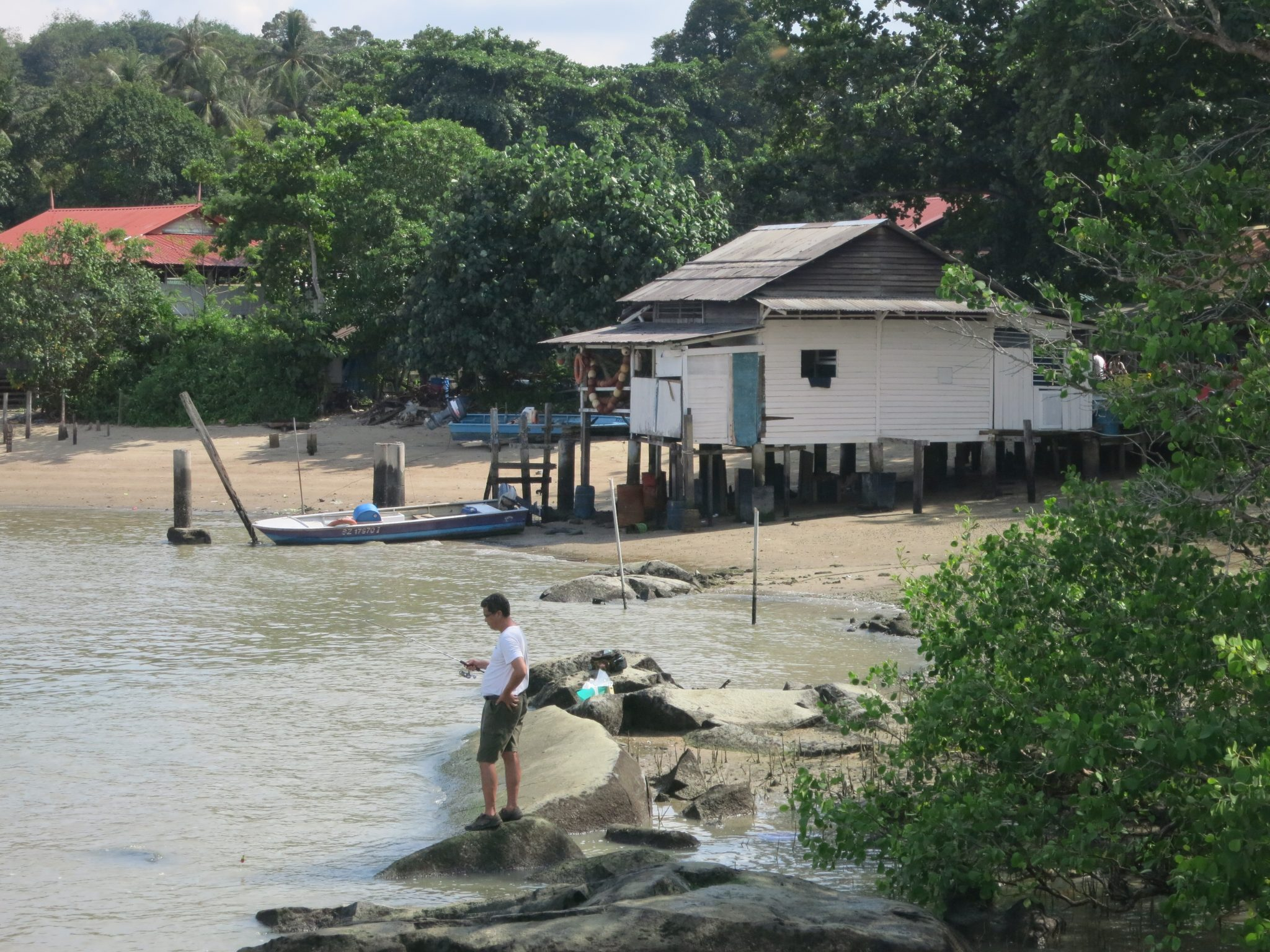 "the beach on Pulau Ubin next to the ferry (""bumboat"") landiing"
