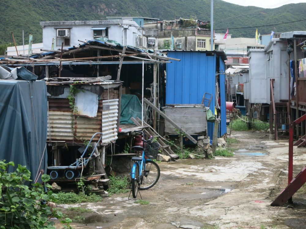 shacks with trash around them in Tai O village