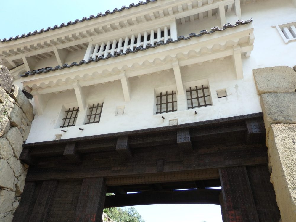 One of the gates to Himeji Castle, with heavy wooden supports and barred windows.