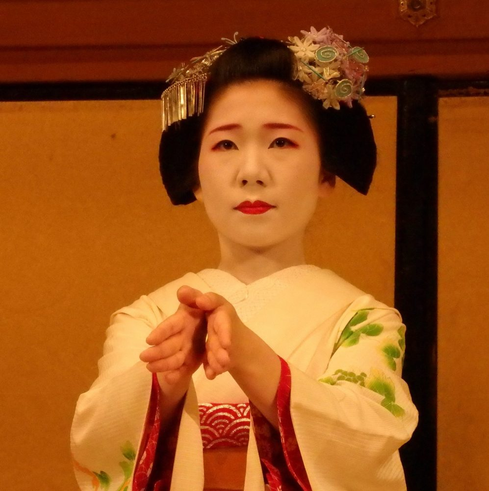 closeup of a Maiko performing at Gion Corner in Kyoto