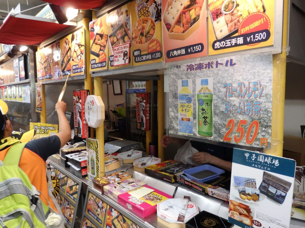 a food stand in the baseball stadium selling bento boxes