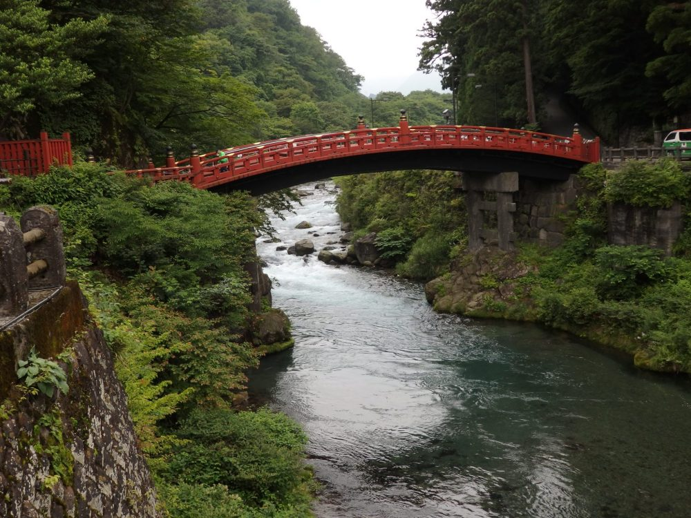 The bright red Shinkyo Sacred Bridge crosses a river in Nikko, Japan: What to see in Nikko