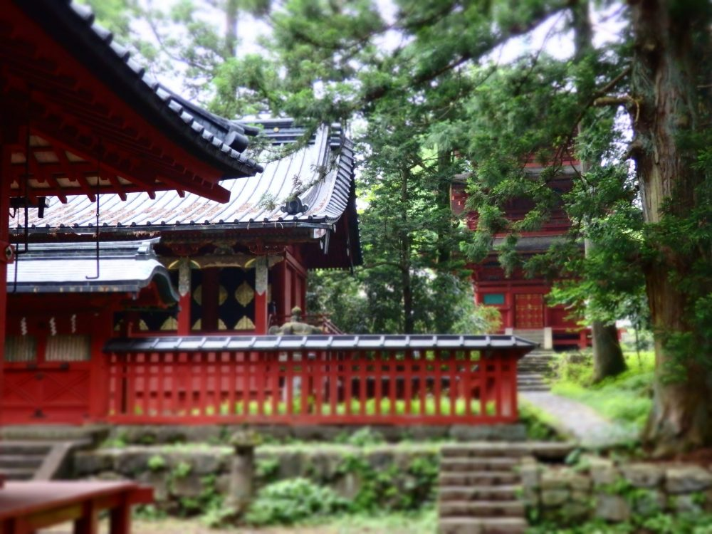 a cluster of small red-painted temples in Nikko, Japan: what to see in Nikko