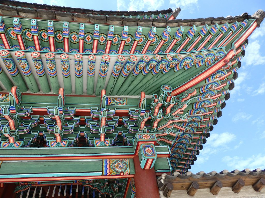 detail of the paintwork under the eaves of a gateway in Changyeonggung Palace