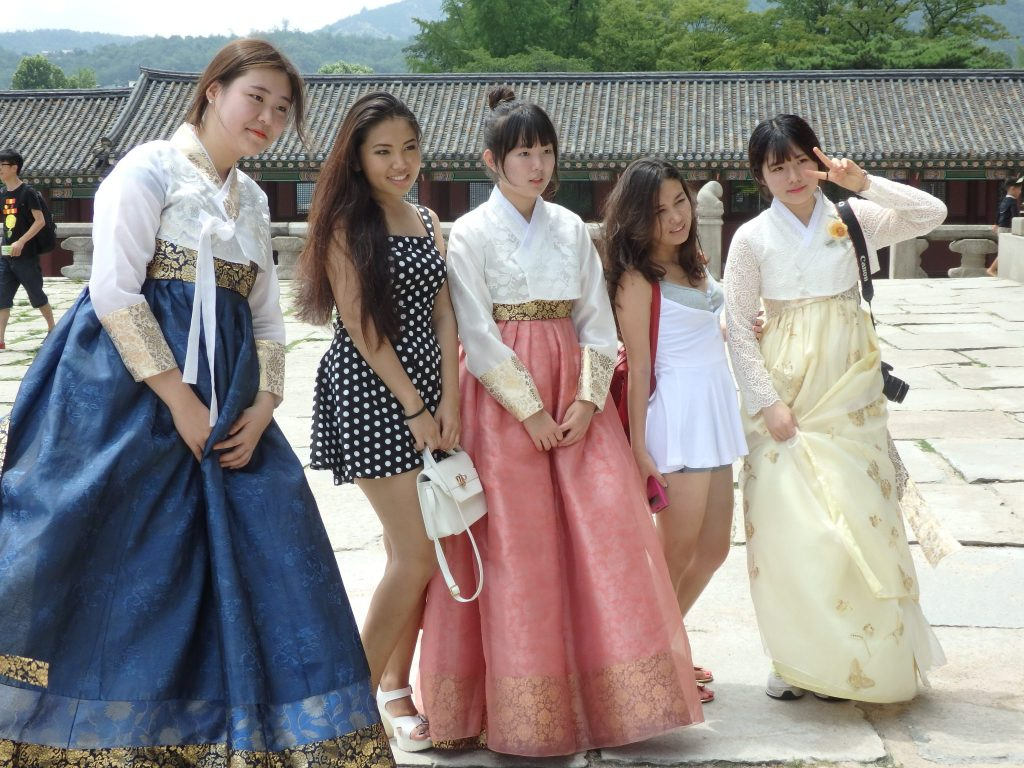 Girls line up for a photo at Gyeongbokgung Palace in Seoul, South Korea