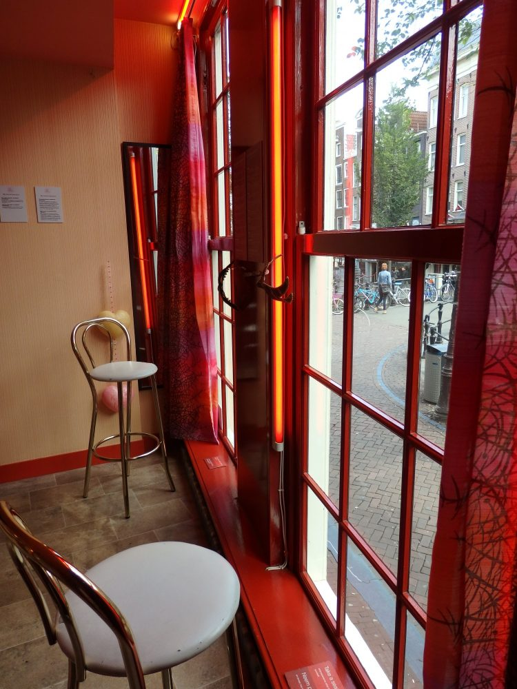 Visitors to Red Light Secrets Museum of Prostitution in Amsterdam can sit in the window to get an idea what it's like for the prostitutes in the red light district.
