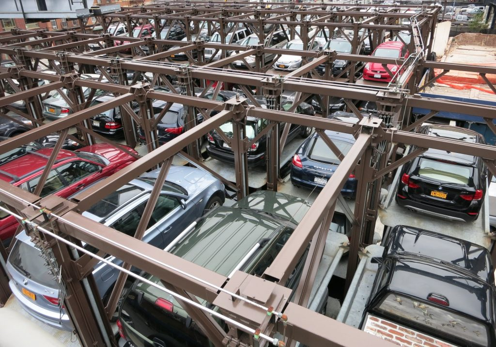 How they park in New York City: piled up using some sort of car lifts.