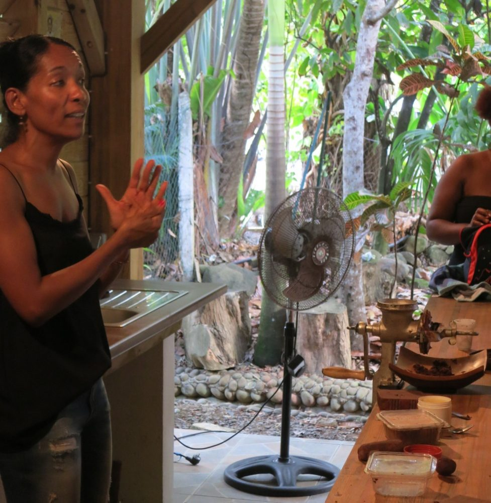 A staff member explains the chocolate-making process at La Maison du Cacao in Guadeloupe.