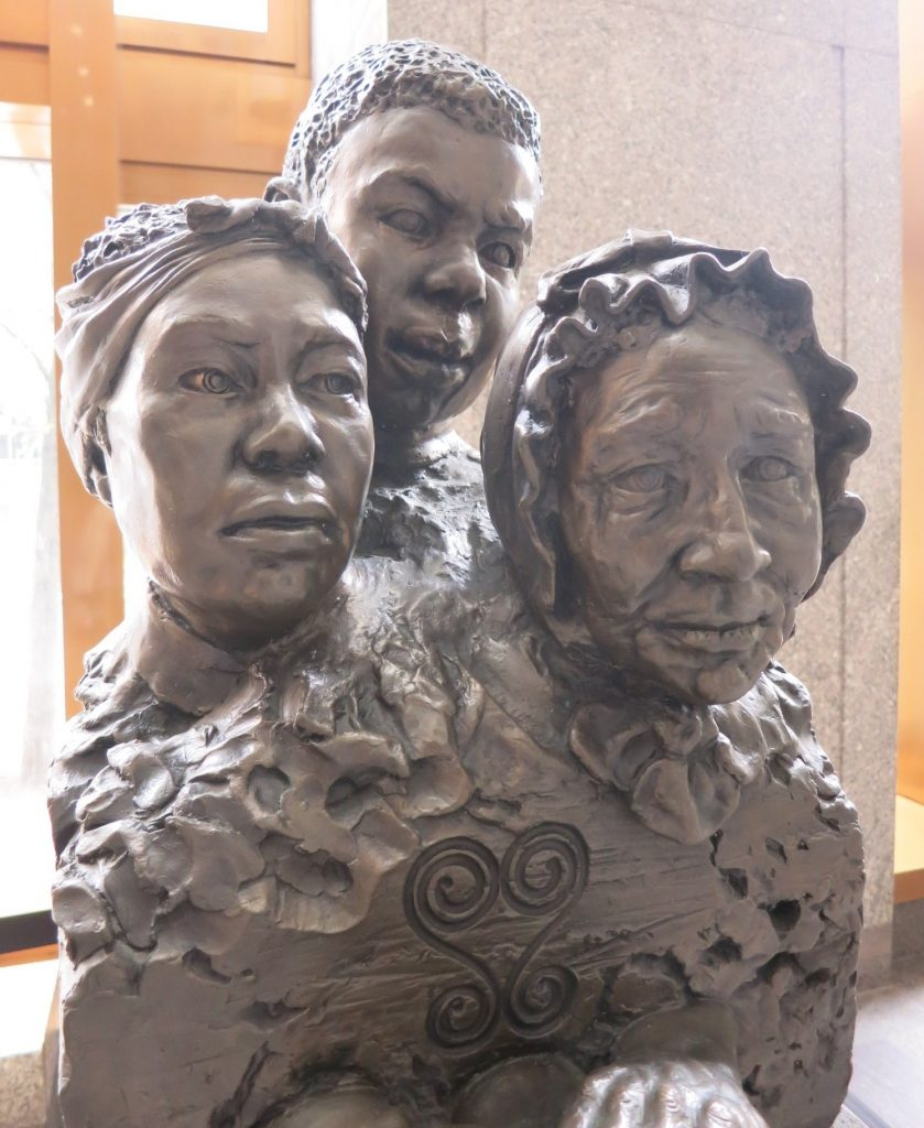"This artwork in the lobby, called ""Unearthed"" and created by Frank Bender, lends a face to the people buried in the African Burial Ground."