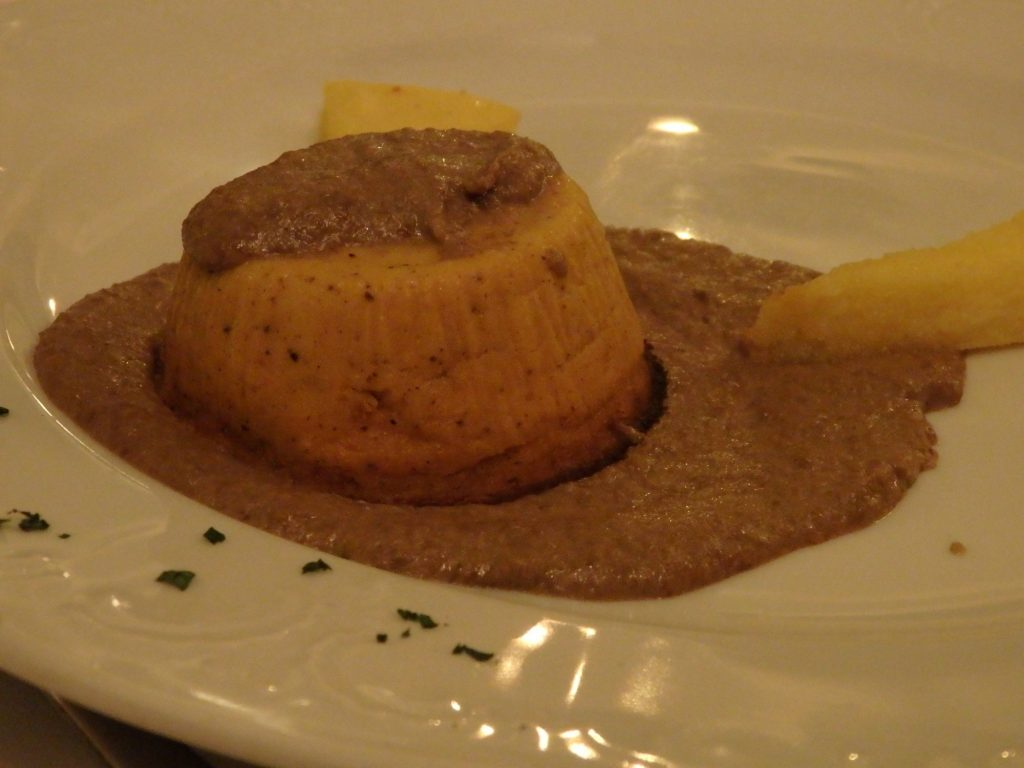 pumpkin tart with polenta and porcini mushroom sauce at Osteria de Poeti in Bologna, Italy