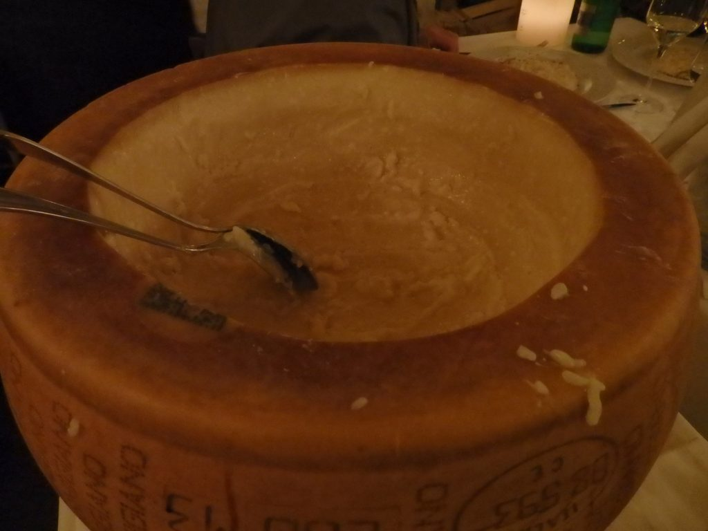 a scooped-out wheel of parmesan cheese, used for making risotto with parmesan at Hosteria de Poeti in Bologna, Italy