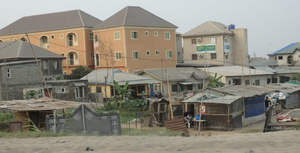 Here you can see recently-built apartment blocks next to small permanent single-family homes next to makeshift shanties, in Lagos, Nigeria.