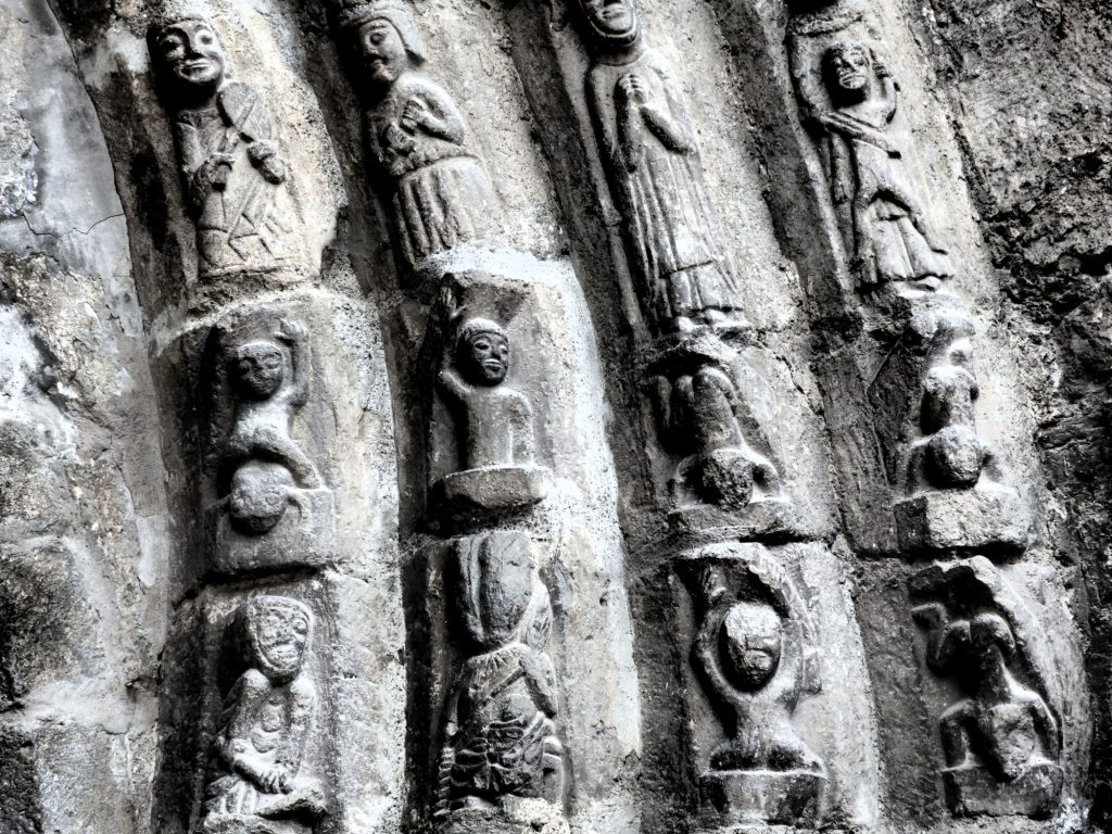 simple carvings above the door of the church of Sant Miqueue in Vielha, Val d'Aran, Spain