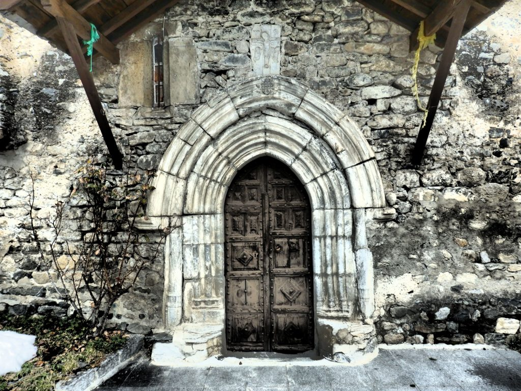 The entrance doorway to Sant Andreu de Casau, Val d'Aran, Spain