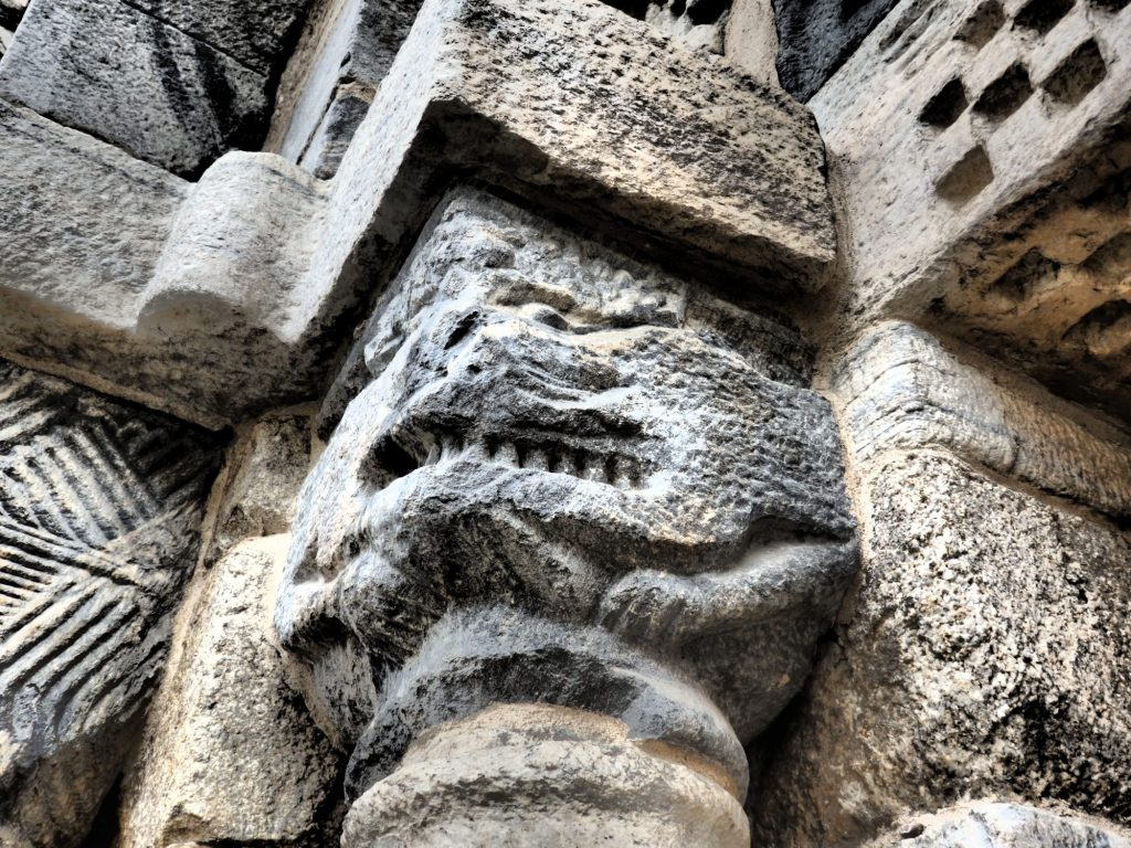 detail carved next to the entrance of the church of Santa Maria at Bossòst, Val d'Aran, Spain