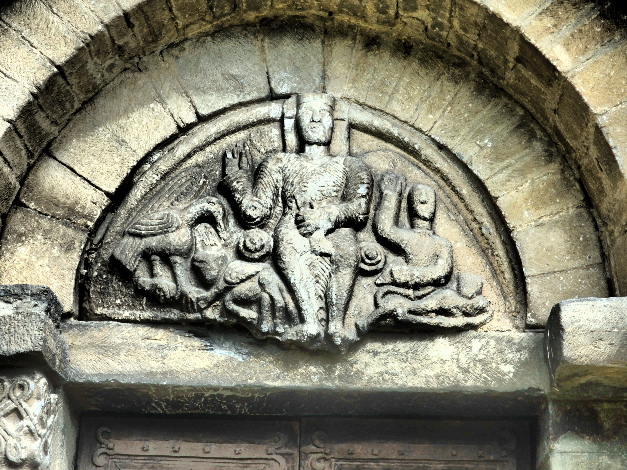 carving above the door of Sant Felix in Vilac, Val d'Aran, Spain