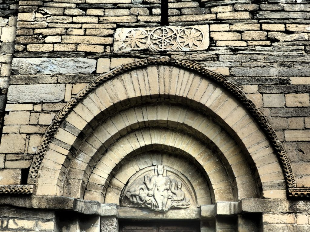 archway above the entrance to the church of Sant Felix in Vilac, Val d'Aran, Spain. Notice the carvings inside and above the archway.