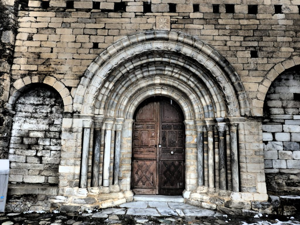 the entrance to Sant Andreu church in Salardu, Val d'Aran, Spain
