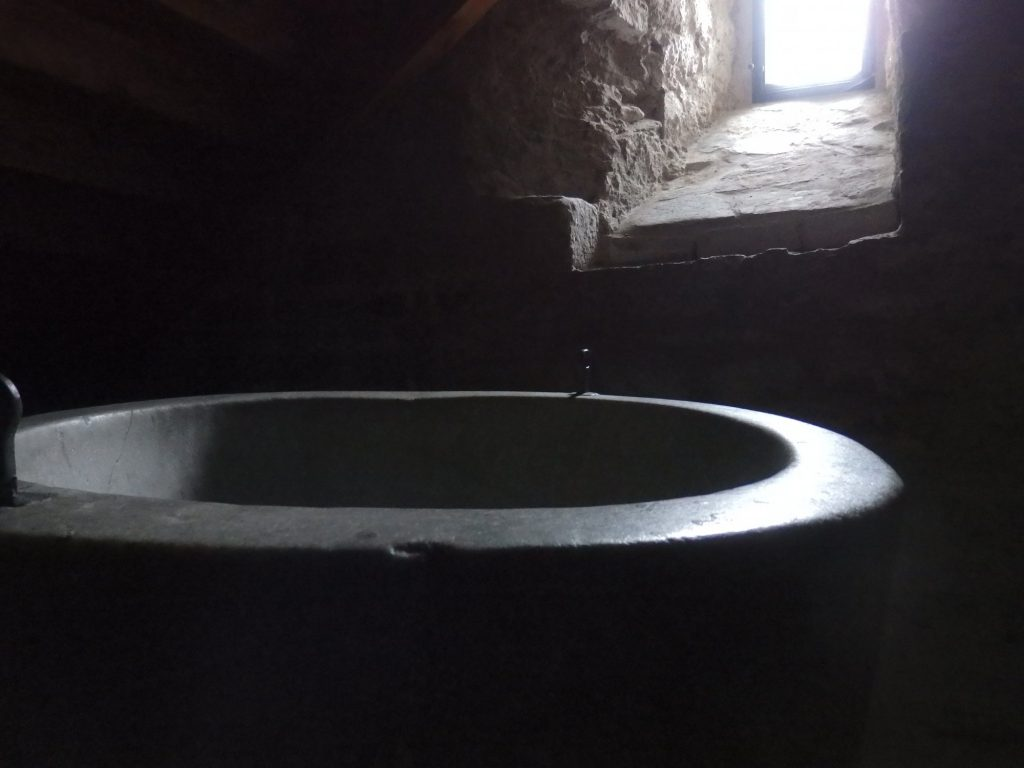 medieval baptismal font in the church at Salardu, Val d'Aran, Spain