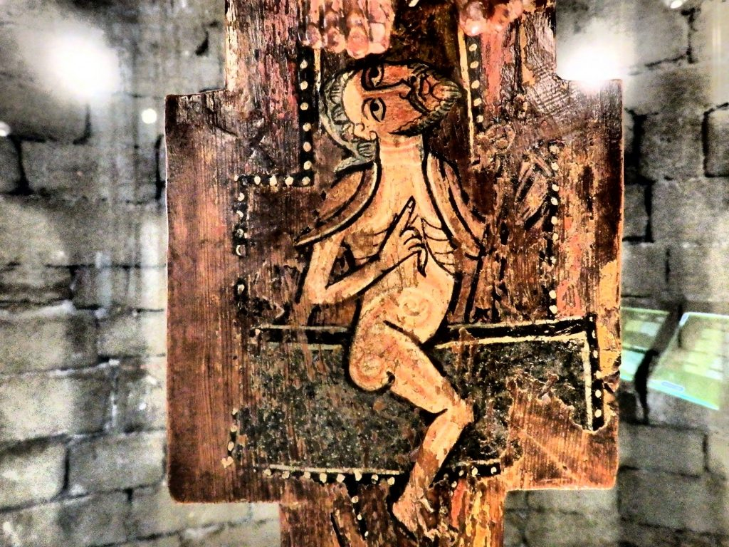 This image is painted on a wooden crucifix, under Jesus's feet, on display in the church in Salardu, in the Val d'Aran in Spain.